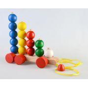 Дерев'яна пірамідка-каталка Кульки на роликах
